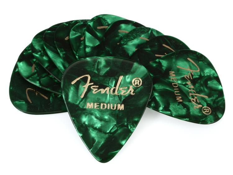 12 x Thin Fender Celluloid Guitar Picks In A Handy Pick Tin 3 Of Each Colour
